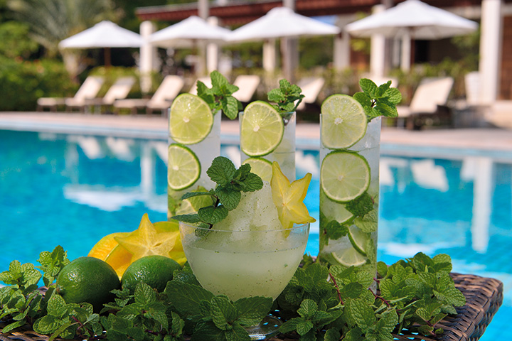 glasses of mojito with lime, mint, star fruitsrs