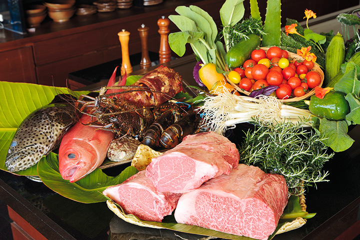 fish, lobstar, vegetables and meat on a table